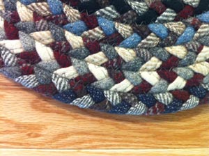 A braided rug made from cloth. Cloth is more durable than yarn.  These braids last a long, long time.