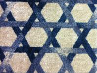 Modern take on basket-weave carpet.