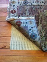 Non-slip rug pads will keep your smaller rugs in place.  Prevent dangerous falls, and protect yourself with a non-slip rug pad.