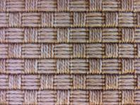 Synthetic sisal area rug that looks just like sisal.