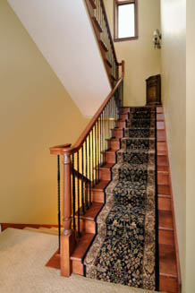 Elegant oriental stair runners.  Expertly installed.