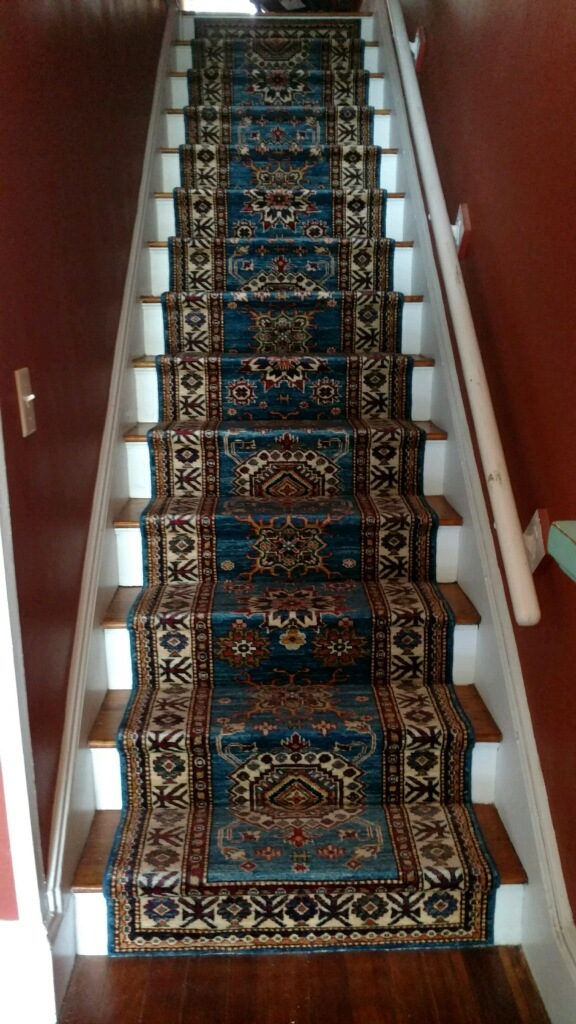 A hand-knotted oriental runner.